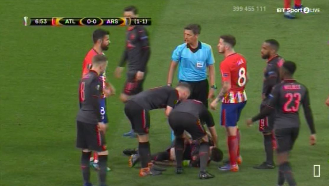 Diego Costa shows true class by urging Atletico Madrid team-mates to put the ball out of play for Laurent Koscielny