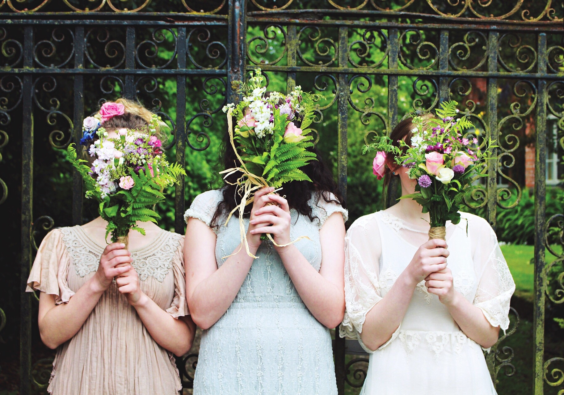 Bridesmaids holding flowers