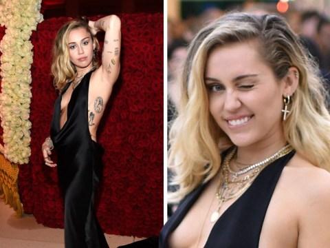 Miley Cyrus leaves Liam Hemsworth at home to own Met Gala red carpet in slinky black gown