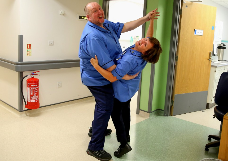 "Picture supplied by Chris Porsz/Bav Media 07976 880732. Picture shows staff at Peterborough District Hospital in 2015. A paramedic has spent more than 40 YEARS photographing the changing face of the NHS at the hospital where he works. Amateur photographer Chris Porsz has taken hundreds of pictures of doctors, nurses, patients and wards at the main hospital in Peterborough, Cambridgeshire over the last four decades. His unique candid photos show how the NHS, which celebrates its 70th anniversary this year, has gone through incredible changes during this time. His pictures from the 1970s show off-duty nurses drinking alcohol and smoking in a social club and radiographers with printed x-rays, rather than digital images which we have today. Other early photos show smiling hospital cleaners hard at work, neatly-dressed nurses and medics cuddling patients. ""Head staff at the hospital knew I enjoyed photography so invited me to document what goes on behind the scenes over the years,"" said Chris, who initially worked as a porter and later as a paramedic. SEE COPY CATCHLINE Unique photos NHS 40 years"