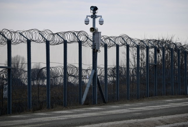The border fence on the Hungarian-Serbian border near the village of Asotthalom is equipped with infra-red cameras and a thermal imaging system, pictured on February 24, 2017. The Hungarian defence forces have been performing construction and security tasks along the whole length of the more than 300-km-long temporary security barrier since July 2015. Several thousand soldiers patrol the border sections 24 hours a day, participating in search and sweep operations and securing the surveillance of the area of responsibility with UAVs and rotary-wing aircraft. / AFP / ATTILA KISBENEDEK (Photo credit should read ATTILA KISBENEDEK/AFP/Getty Images)