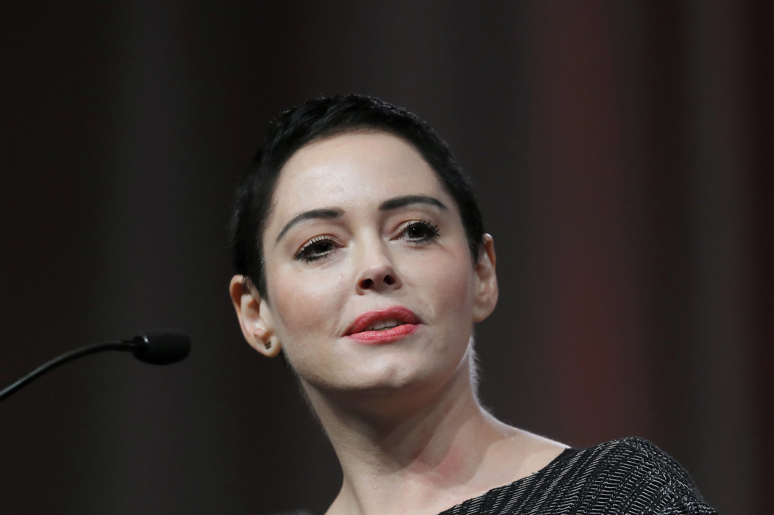 FILE- In this Oct. 27, 2017, file photo, actress Rose McGowan speaks at the inaugural Women's Convention in Detroit. A judge is scheduled to hear evidence on whether a drug possession charge in Virginia against McGowan should go forward. McGowan is seeking to have the charges against her dismissed. She has suggested the drugs may have been planted by agents hired by disgraced Hollywood producer Harvey Weinstein. (AP Photo/Paul Sancya, File)