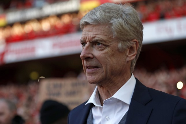 Arsenal's French manager Arsene Wenger waits to appear for a presentation on the pitch after the English Premier League football match between Arsenal and Burnley at the Emirates Stadium in London on May 6, 2018. Arsene Wenger bids farewell to a stadium he helped to build in more ways than one when he leads Arsenal at the Emirates for the final time at home to Burnley on Sunday. Wenger's final season after 22 years in charge is destined to end in disappointment after Thursday's Europa League semi-final exit. / AFP PHOTO / Adrian DENNIS / RESTRICTED TO EDITORIAL USE. No use with unauthorized audio, video, data, fixture lists, club/league logos or 'live' services. Online in-match use limited to 75 images, no video emulation. No use in betting, games or single club/league/player publications. / ADRIAN DENNIS/AFP/Getty Images