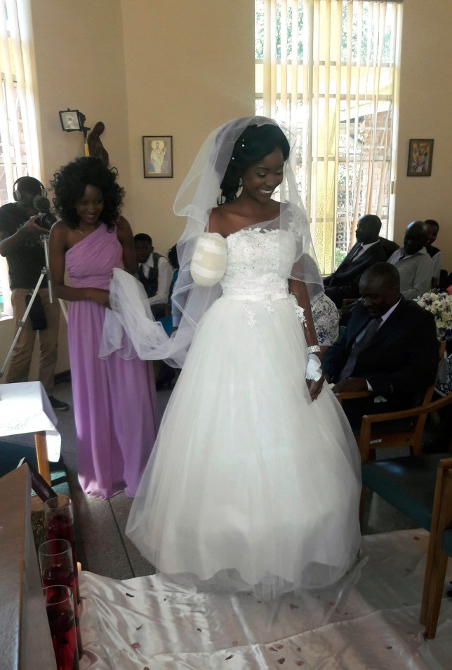 """CORRECTS FIRST NAME TO ZENELE FROM ZANELE - In this photo taken on Saturday, May, 5, 2018, Zenele Ndlovu walks down the aisle on her wedding day at a hospital Chapel in Bulawayo, Zimbabwe. Ndlovu and Jamie Fox, attacked by a crocodile, wedded days later in a Zimbabwean hospital, where Ndlovu was recovering after losing an arm. """"In one week we went from shock and agony to a truly amazing experience,"""" Fox told The Associated Press on Monday, May 7. (AP Photo)"""