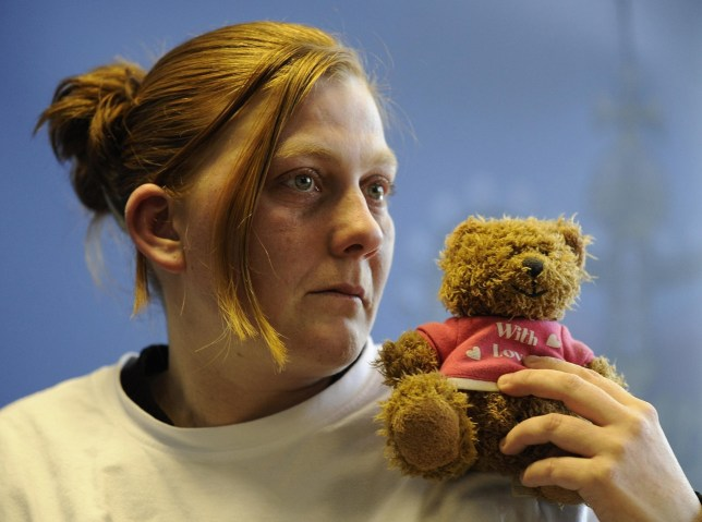 File photo dated 3/3/2008 of Karen Matthews, the mother of missing 9-year-old Shannon Matthews, holding her daughter's favourite teddy bear as she makes an emotional appeal for her safe return.