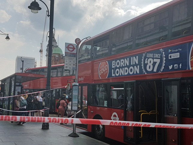 Police tape around a bus on Brixton Road in south London where a young woman was believed to have been attacked with a noxious substance. PRESS ASSOCIATION Photo. Picture date: Tuesday May 8, 2018. Reports on social media described the victim, who is aged in her twenties, being hosed down with water by firefighters. See PA story POLICE Noxious. Photo credit should read: Tess De La Mare/PA Wire
