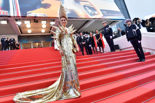 "Russian businesswoman and tv presenter Elena Lenina poses as she arrives on May 8, 2018 for the screening of the film ""Todos Lo Saben (Everybody Knows)"" and the opening ceremony of the 71st edition of the Cannes Film Festival in Cannes, southern France. / AFP PHOTO / LOIC VENANCELOIC VENANCE/AFP/Getty Images"