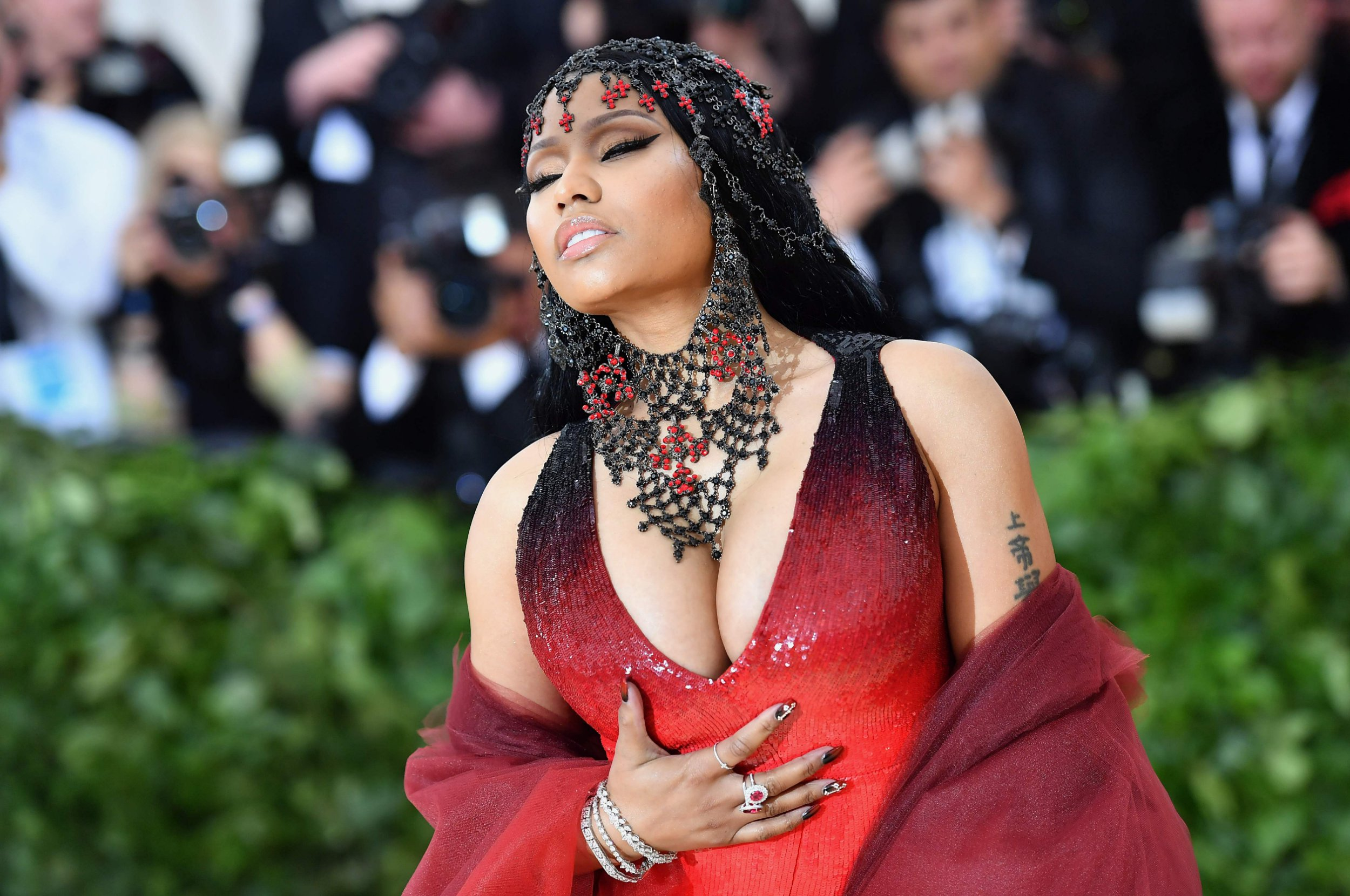 Nicki Minaj arrives for the 2018 Met Gala on May 7, 2018, at the Metropolitan Museum of Art in New York. The Gala raises money for the Metropolitan Museum of Arts Costume Institute. The Gala's 2018 theme is Heavenly Bodies: Fashion and the Catholic Imagination. / AFP PHOTO / ANGELA WEISSANGELA WEISS/AFP/Getty Images