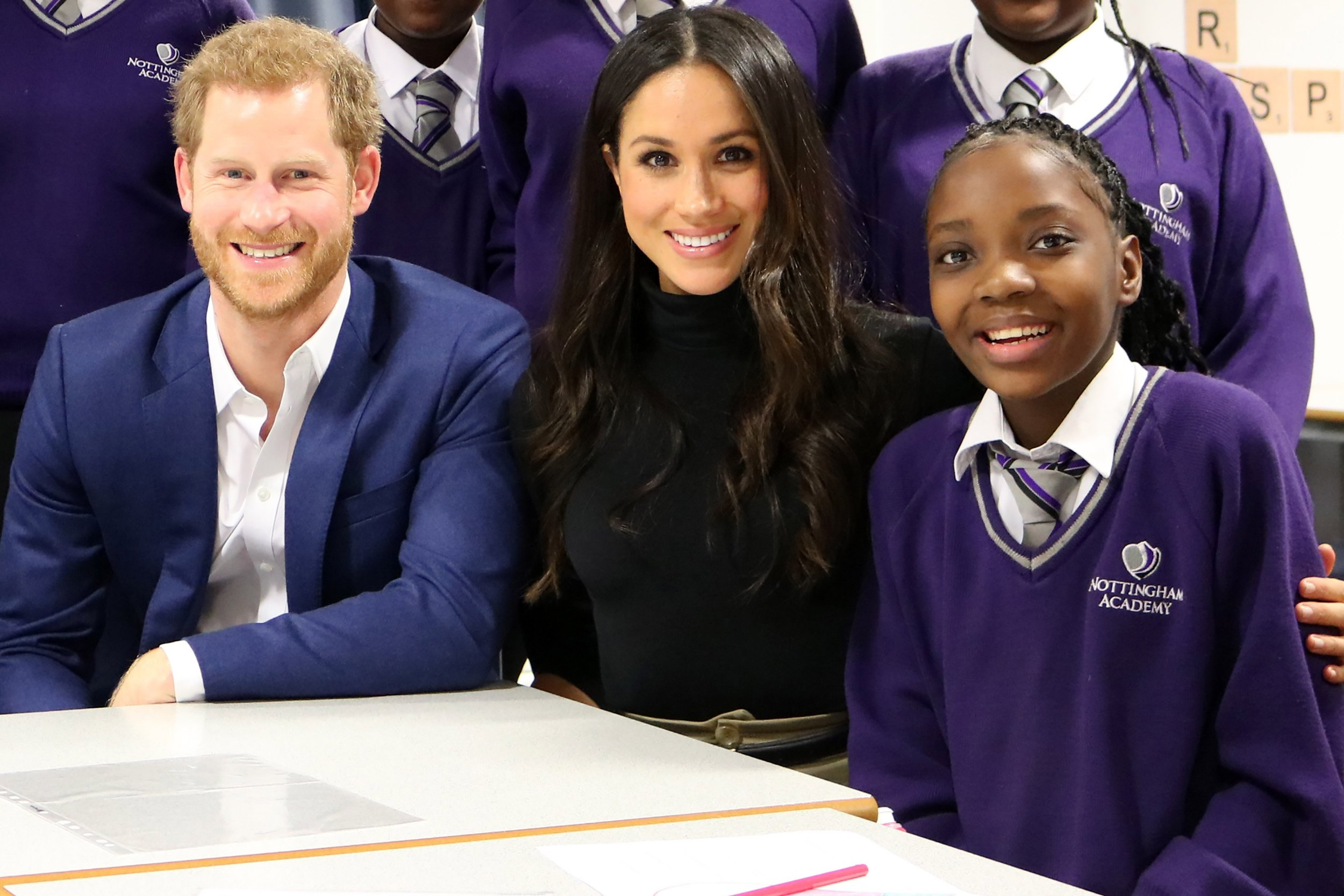 Pics from Caters News - (Pictured: Prince Harry with his fiance Meghan Markle and Nottingham school girl Leonora Ncomanzi) - A schoolgirl with dreams of becoming an actress has been handed an invite to the Royal Wedding after <a href=
