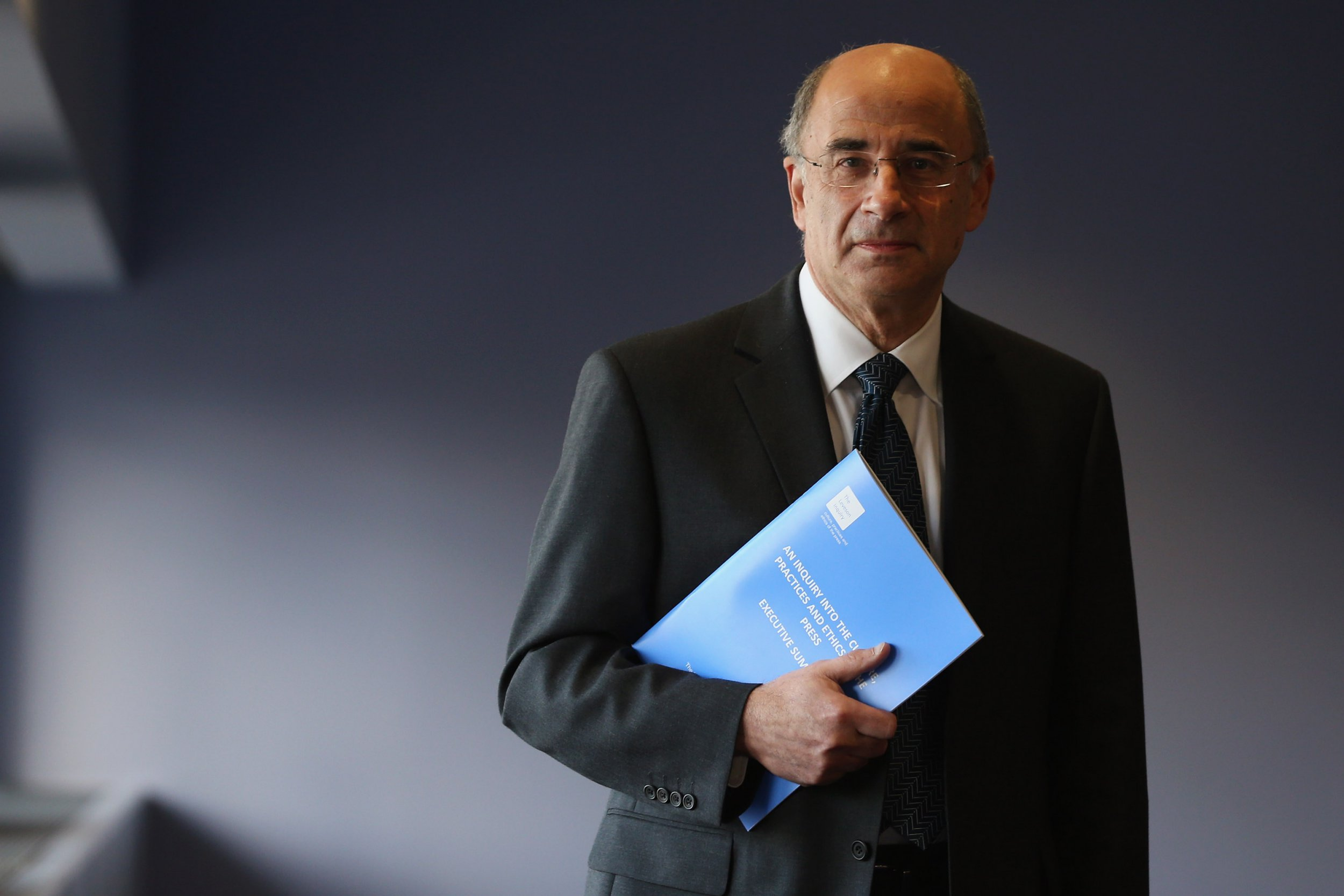 LONDON, ENGLAND - NOVEMBER 29: Lord Justice Leveson poses with a summary report into press standards on November 29, 2012 in London, England. The findings of the Leveson Inquiry, which focus on the culture, practices and ethics of the press, was published today after a 16 month inquiry. (Photo by Dan Kitwood/Getty Images)