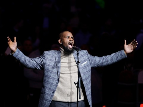 R Kelly toasts with friends and claims it's 'too late' to silence him after Spotify bans promotion of his music