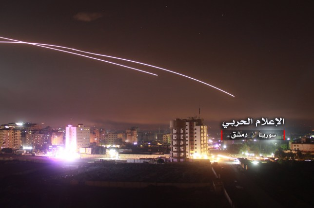 epa06724730 A handout photo made available by government-affiliated Syrian Military Media is said to show Syrian air defense missiles intercepting missile strikes over Damascus, Syria, 09 May 2018 (issued 10 May 2018). According to Syrian official media reports, the air defense was responding to a new wave of Israeli missile strikes. EPA/SYRIAN MILITARY MEDIA HANDOUT HANDOUT EDITORIAL USE ONLY/NO SALES