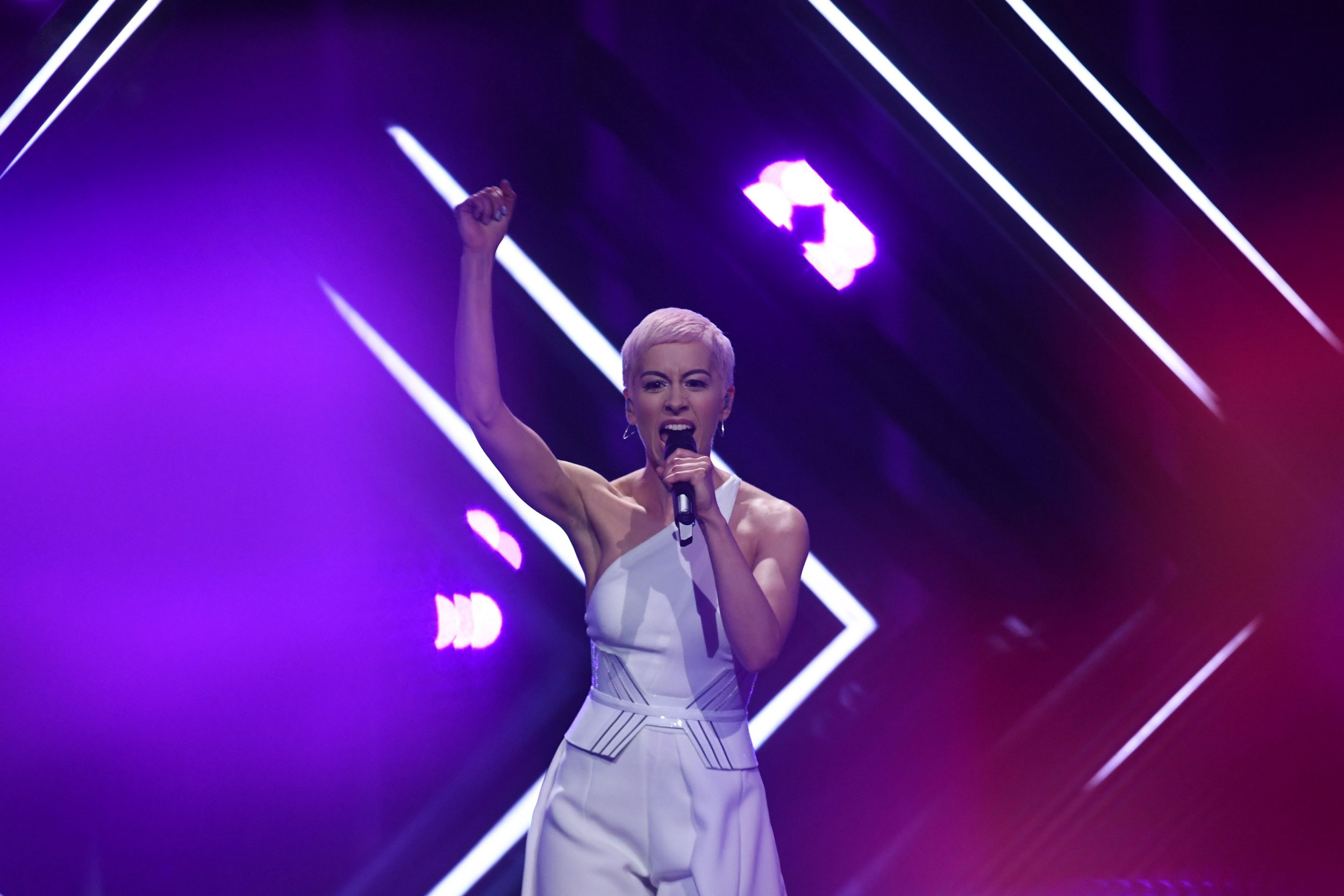 "Britain's singer Susanna Marie Cork aka SuRie performs ""Storm"" during the final of the 63rd edition of the Eurovision Song Contest 2018 at the Altice Arena in Lisbon, on May 12, 2018. / AFP PHOTO / Francisco LEONGFRANCISCO LEONG/AFP/Getty Images"