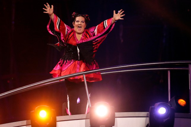 epa06732202 Netta from Israel celebrates after she won the Grand Final of the 63rd annual Eurovision Song Contest (ESC) at the Altice Arena in Lisbon, Portugal, 12 May 2018. EPA/JOSE SENA GOULAO