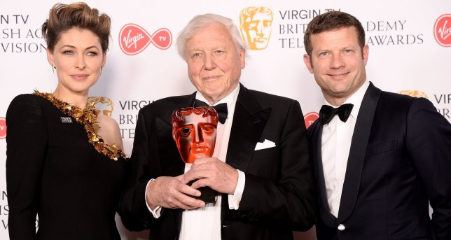 LONDON, ENGLAND - MAY 13: Presenters Emma Willis (L) and Dermot O'Leary (R) with Sir David Attenborough with the award for Virgin TV Must See Moment for 'Blue Planet II', pose in the press room at the Virgin TV British Academy Television Awards at The Royal Festival Hall on May 13, 2018 in London, England. (Photo by Dave J Hogan/Dave J Hogan/Getty Images)