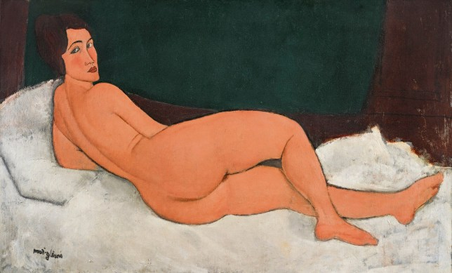 "This 1917 oil painting, ""Nu couche (sur le cote gauche)"" by Amedeo Modigliani, was auctioned at Sotheby's in New York for more than $157 million, in their Impressionist & Modern Art evening sale Monday, May 14, 2018. Sotheby???s says the painting had the highest pre-auction estimate for an artwork at $150 million. (Sotheby's via AP)"