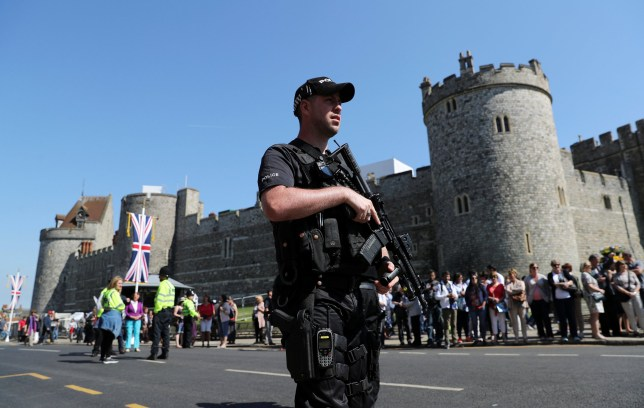 Armed police patrol ahead of the changing of the guard ceremony in Windsor, Britain, May 15, 2018. REUTERS/Marko Djurica