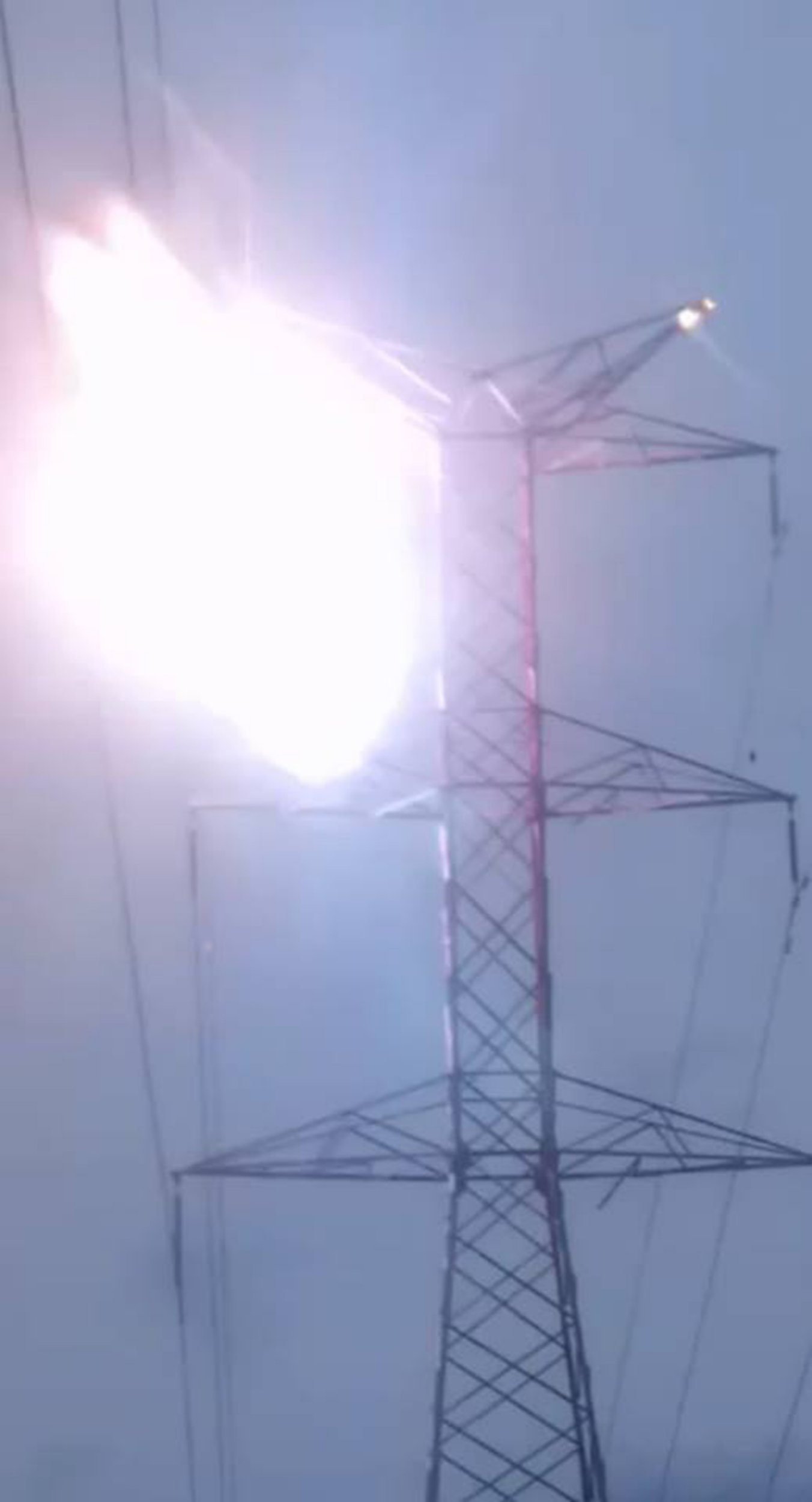 """Pic shows: The moment Victor Jose Arroyo Gonzalez got electrocuted and fell off the tower. This is the tragic moment a deaf-mute young man fell more than 160 feet to his death from an electricity pylon when he touched live wires after giving up on his suicide bid. Victor Jose Arroyo Gonzalez, 20, had scaled the huge pylon in the city of Barranquilla in northern Colombia???s Atlantico department and threatened to throw himself off. But police officers and onlookers reportedly talked him out of killing himself and he had just started climbing back down when tragedy struck, according to reports. There was a huge flash and a cloud of smoke as the young man touched a live wire and he fell from near the top of the pylon. His limp body flipped around another cable lower down before somersaulting all of the way to the ground below as a crowd of onlookers screamed in horror. The disturbing scenes were captured on the smartphones of eyewitnesses in the Los Olivos area of the city. Mr Gonzalez had earlier been heard shouting: """"I am going to throw myself off, I do not want to continue living anymore, I cannot cope anymore."""" He was declared dead at the scene. The deaf mute man was reportedly suffering from depression and had previously climbed tall structures to threaten suicide. Barranquilla, a port on the Caribbean Sea, is the only major city in South America that was populated before its formal foundation by Europeans. (ends)"""