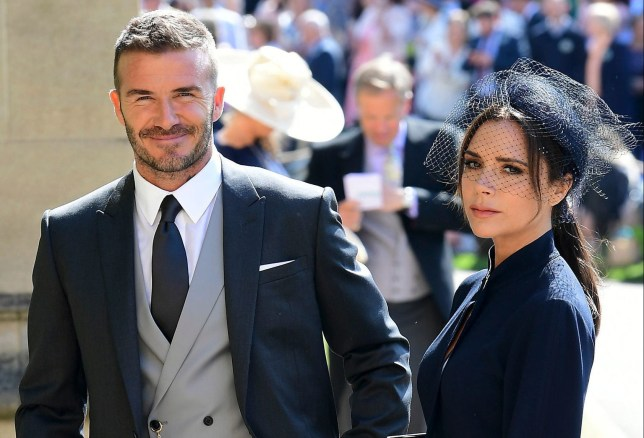 Former England footballer David Beckham (L) and fashion designer Victoria Beckham (R) arrive for the wedding ceremony of Britain's Prince Harry, Duke of Sussex and US actress Meghan Markle at St George's Chapel, Windsor Castle, in Windsor, on May 19, 2018. / AFP PHOTO / POOL / Ian WestIAN WEST/AFP/Getty Images