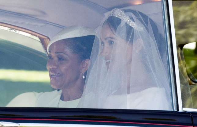 WINDSOR, UNITED KINGDOM - MAY 19: Meghan Markle and her mother Doria Ragland leave Cliveden House Hotel as they make their way to St George's Chapel at Windsor Castle before the wedding of Prince Harry to Meghan Markle on May 19, 2018 in Windsor, England. (Photo by Phil Harris - WPA Pool/Getty Images)