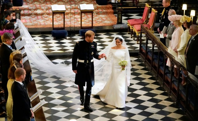 Britain's Prince Harry and Meghan Markle leave after their wedding ceremony at St. George's Chapel in Windsor Castle in Windsor, near London, England, Saturday, May 19, 2018. (Owen Humphreys/pool photo via AP)