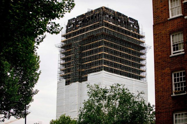 Construction work is seen continuing on the burned-out shell of Grenfell Tower in west London on May 11, 2018. - British Prime Minister Theresa May on May 11, bowed to pressure from families of the 71 people who died in last year's Grenfell Tower fire by appointing new experts to assist an inquiry into the blaze. The first stage of The Grenfell Tower inquiry was set to begin on May 21. (Photo by Tolga AKMEN / AFP) (Photo credit should read TOLGA AKMEN/AFP/Getty Images)