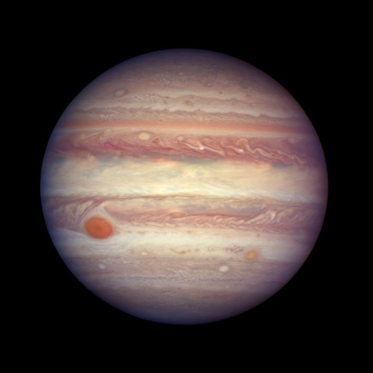 FILE - This April 3, 2017 file image made available by NASA shows the planet Jupiter when it was at a distance of about 668 million kilometers (415 million miles) from Earth. On Monday, May 21, 2018, scientists reported that an asteroid sharing Jupiter???s orbit, but in reverse, actually hails from a neighboring star system. They say the asteroid, known as 2015 BZ509, has been in this peculiar backward orbit ever since getting sucked into our solar system in the first moments after our solar system formed 4.5 billion years ago. (NASA, ESA, and A. Simon (GSFC) via AP, File)
