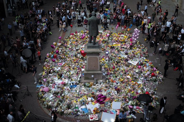 MANCHESTER, ENGLAND - MAY 25: The carpet of floral tributes to the victims and injured of the Manchester Arena bombing covers the ground in St Ann's Square on May 25, 2017 in Manchester, England. An explosion occurred at Manchester Arena as concert goers were leaving the venue after Ariana Grande had performed. Greater Manchester Police are treating the explosion as a terrorist attack and have confirmed 22 fatalities and 59 injured. (Photo by Christopher Furlong/Getty Images)