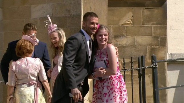 Enterprise News and Pictures 21/5/18 Pic shows: Guest David Beckham poses for a photograph with Manchester Arena bombing survivor Amelia Mae Thompson, 12, before making his way inside the church during the televised live footage of Prince Harry and Meghan's wedding on Saturday. See story...