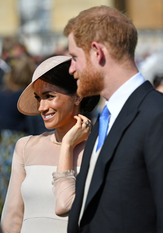Britain's Prince Harry and his wife Meghan, Duchess of Sussex attend a garden party at Buckingham Palace, their first royal engagement as a married couple, in London, May 22, 2018. Dominic Lipinski/Pool via Reuters