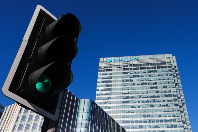A green traffic light directs traffic near Barclays Plc head offices at the Canary Wharf business district in London, U.K., on Tuesday, March 21, 2017. Barclays is considering Dublin for their EU base to ensure continued access to the single market, said people familiar with the plans,asking not to be named because the plans aren't public. Photographer: Luke MacGregor/Bloomberg via Getty Images