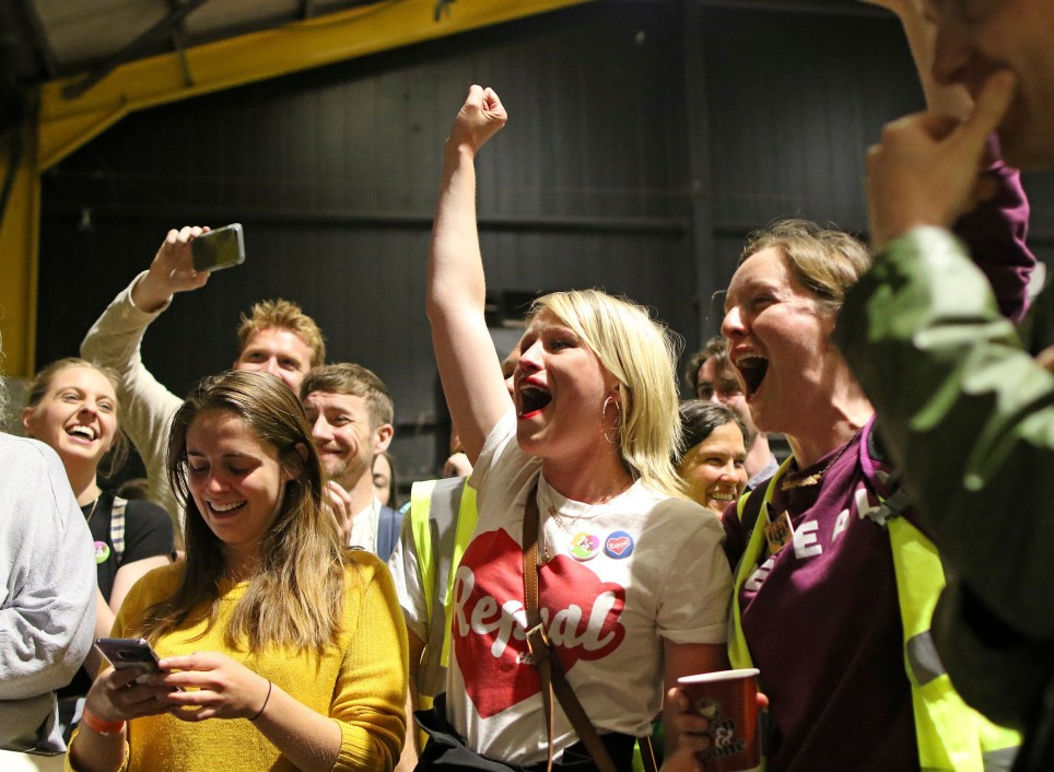 """People from the """"Yes"""" campaign react, as the results of the votes begin to come in the Irish referendum on the 8th Amendment of the Irish Constitution at the RDS count centre, in Dublin, Ireland, Saturday May 26, 2018. Ireland appeared to move away from its conservative Roman Catholic roots and embrace a more liberal view Friday as two major exit polls predicted voters had repealed a constitutional ban on abortion. (AP Photo/Peter Morrison)"""
