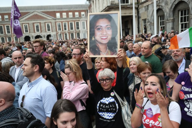 A supporter holds photo of Savita Halappanavar in Dublin Castle as Ireland has voted to repeal the 8th Amendment of the Irish Constitution which prohibits abortions unless a mother's life is in danger. PRESS ASSOCIATION Photo. Picture date: Saturday May 26, 2018. See PA story IRISH Abortion. Photo credit should read: Niall Carson/PA Wire