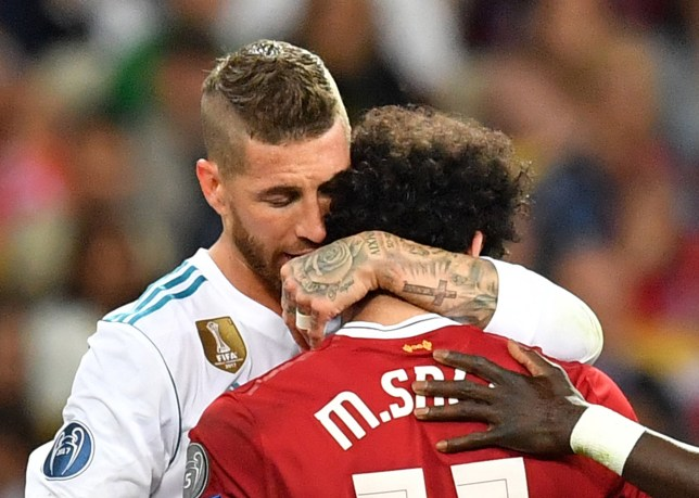 epa06765574 Sergio Ramos of Real Madrid (L) hugs Mohamed Salah of Liverpool (R) as he is let off the pitch for a medical check during the UEFA Champions League final between Real Madrid and Liverpool FC at the NSC Olimpiyskiy stadium in Kiev, Ukraine, 26 May 2018. EPA/GEORGI LICOVSKI
