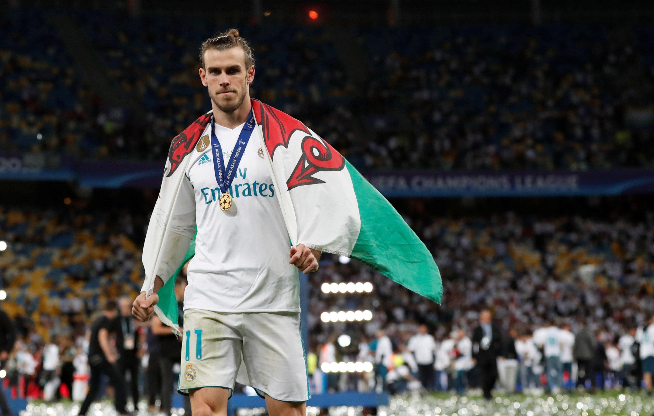 Gareth Bale preferred to talk to Liverpool's Adam Lallana than celebrate with team-mates in Kiev