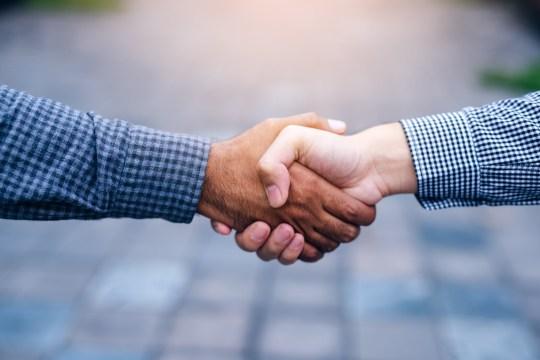 Scene of businessman handshake in outdoors