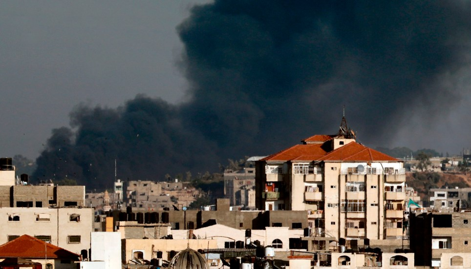 "A picture taken from Gaza City on May 29, 2018 shows smoke billowing in the background following an Israeli air strike on the Palestinian coastal enclave. Israel's military struck more than 30 ""military targets"" in the Gaza Strip today in response to a barrage of rocket and mortar fire from the Palestinian enclave, the army said. / AFP PHOTO / THOMAS COEXTHOMAS COEX/AFP/Getty Images"