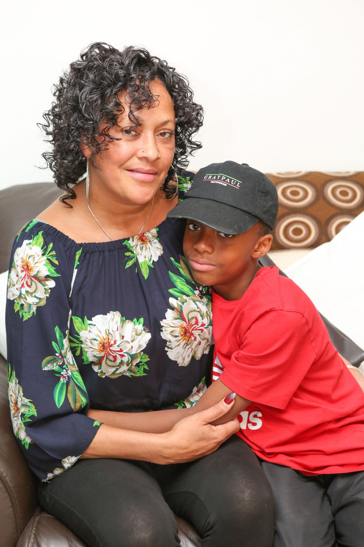 A 10-year-old boy had to walk 45 minutes home after school after he was not allowed to board a bus because he was 10p short. The boy's mother, Amanda Johnson, has spoken of her worry and upset after her son was not allowed onto a bus and made to walk from Ebury Road in Carrington to Mansfield Road near to the Arboretum, Nottingham. caption: Amanda Johnson with her son Jovanni Bojang, 10