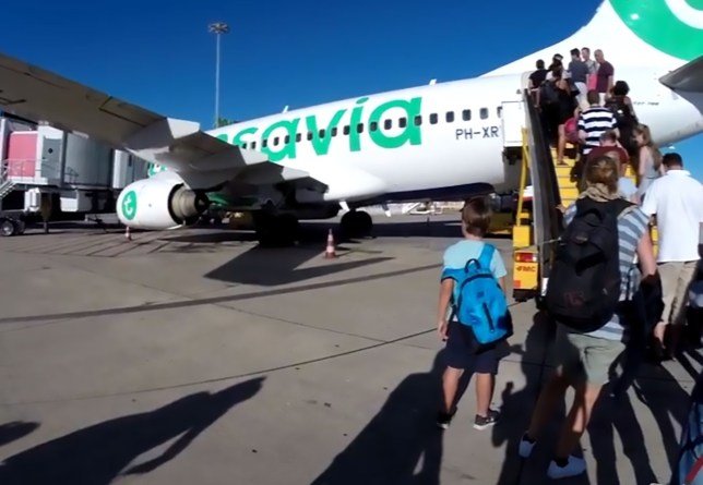 "Pics shows: A Transavia plane at Faro Airport, Portugal; A plane full of tourists had to make an emergency landing after a smelly passenger???s body odour caused other holidaymakers to vomit and faint. The flight to the Spanish holiday island of Gran Canaria was forced to make an unexpected detour as passengers became distressed by the stench of the ""unwashed"" man. He smelt so bad that other passengers started fainting and vomiting after the flight took off from Schiphol Airport, which serves the Dutch capital of Amsterdam. Staff on board the Transavia service reportedly tried to quarantine him in a toilet of the Boeing 737 before the pilots diverted the flight. They landed in the city of Faro, in the Algarve region of southern Portugal, so the foul-smelling man could be removed from the flight. A picture taken by one of the passengers show medical personnel taking the smelly man from the aeroplane into a bus. Belgian passenger Piet van Haut was one of the passengers on board the plane and described the stench of the man in question as ""unbearable"". He said: ""It was like he hadn't washed himself for several weeks. Several passengers got sick and had to puke."" Transavia confirmed the emergency landing saying it was due to ""medical reasons"". It is not known why the man smelt so bad and what other medical issues he was suffering from. A Transavia spokesman said: ""The aeroplane diverted because of medical reasons, but it is indeed right that he smelled quite a bit."" Bizarrely, it was not the first smelly incident on a Transavia flight this year. In February, a Transavia plane from Dubai to Amsterdam was forced to make an emergency landing in the Austrian capital of Vienna after a passenger could not stop farting, which caused a brawl between several passengers."