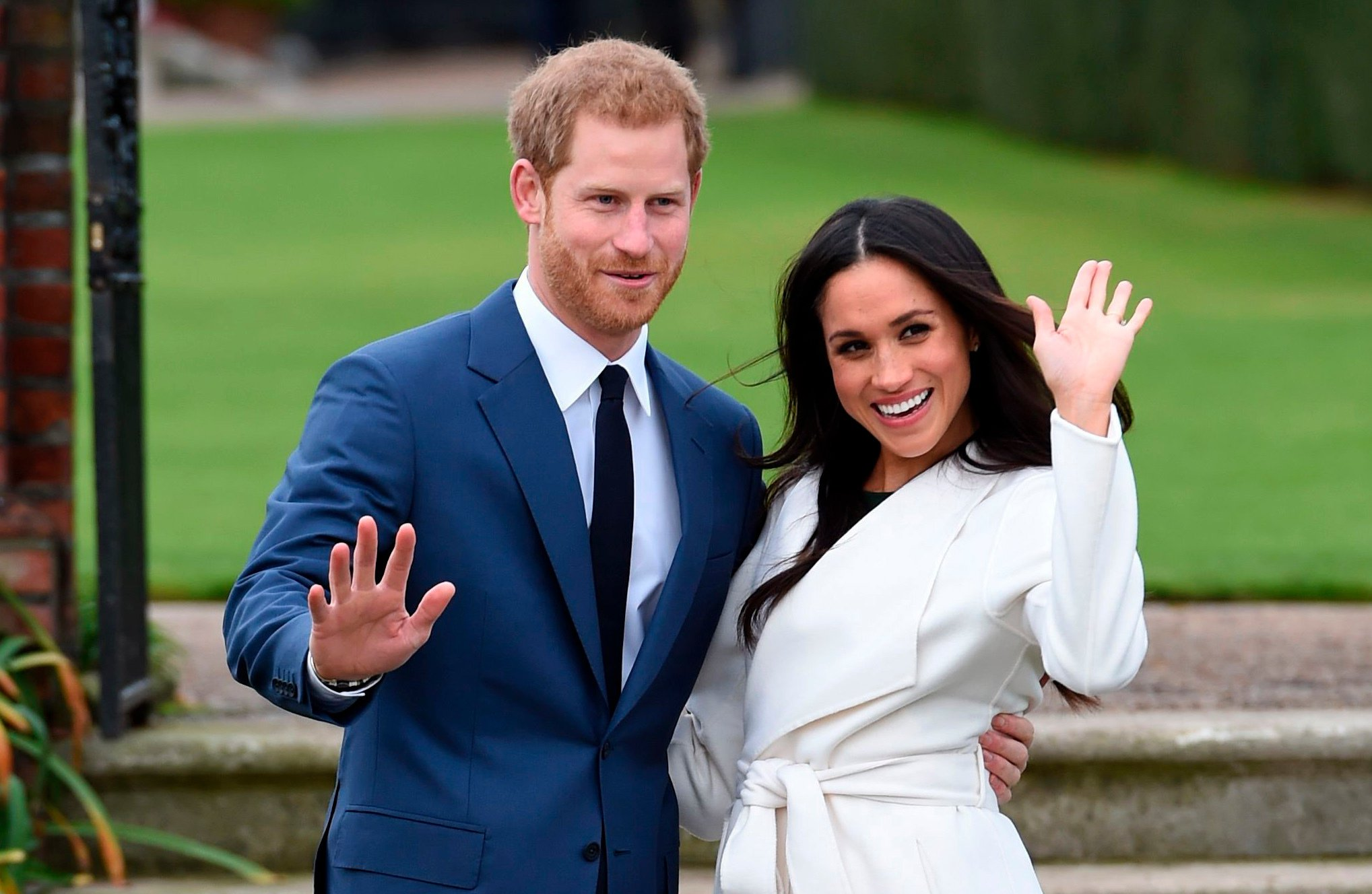 FILE - In this Nov. 27, 2017 file photo, engaged couple Britain's Prince Harry, left, and Meghan Markle pose for the media at Kensington Palace in London. The wedding of Prince Harry and Meghan Markle comes with a world of etiquette and protocol for guests. While the upper crust among them may be well initiated, newbies from Hollywood could be attending their first royal affair. The royal nuptials will take place on Saturday, May 19. (Eddie Mulholland/Pool via AP)