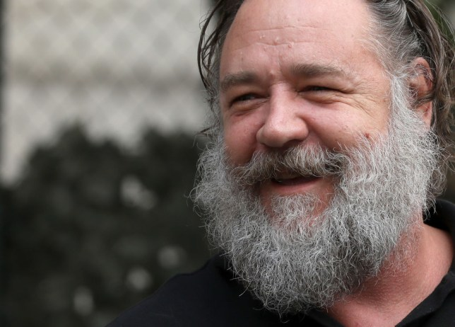Russell Crowe Shows No Sign Of Shaving Beard As He Enjoys A Beer