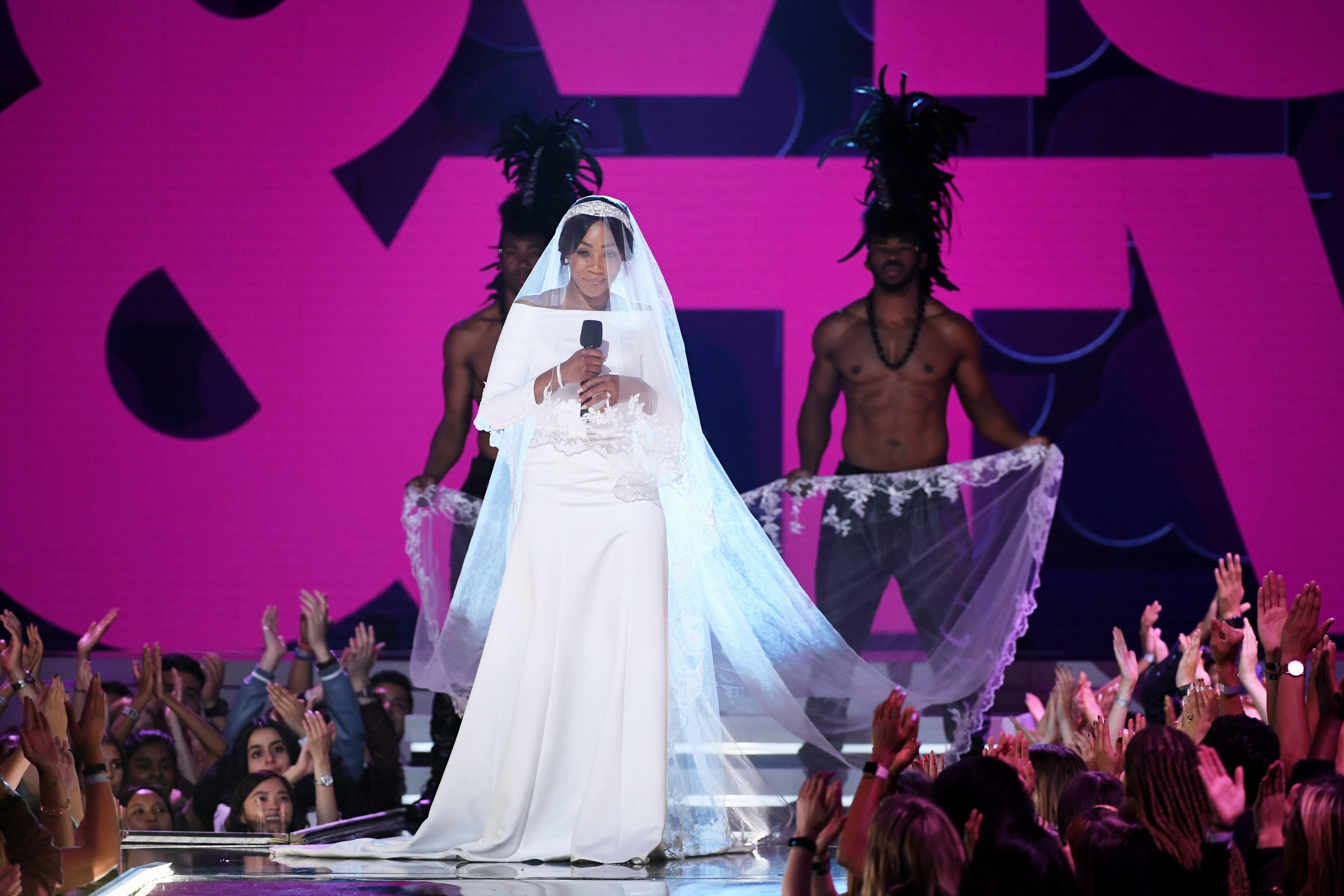 Tiffany Haddish is ready for Leonardo DiCaprio as she 'wears Meghan Markle's wedding dress' to MTV Movie & TV Awards