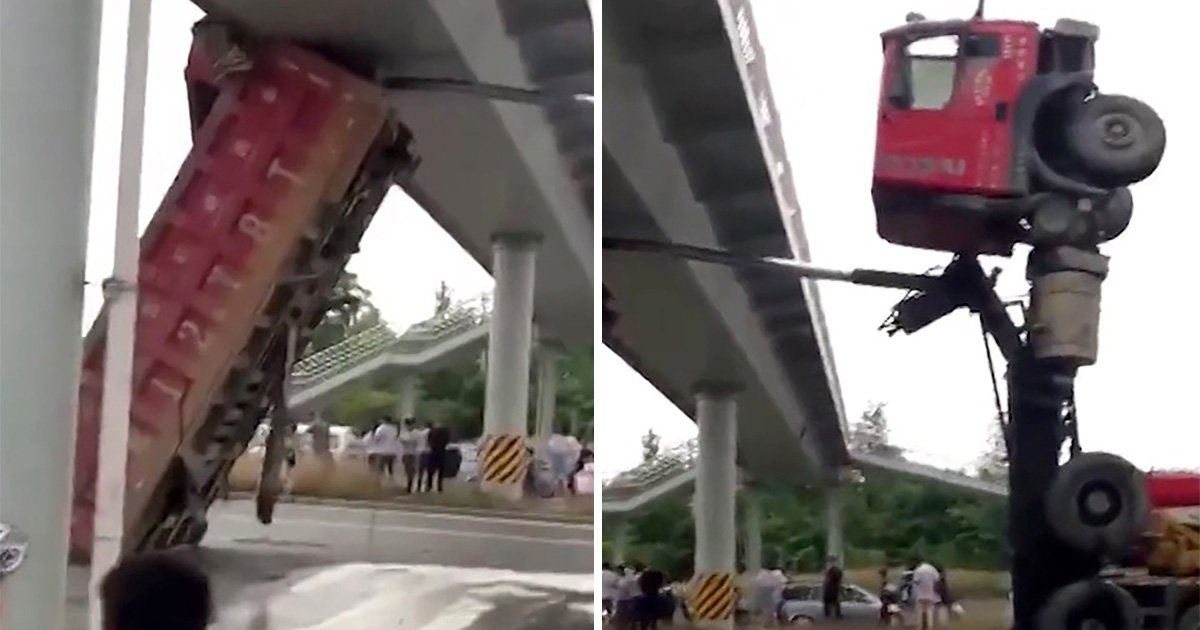Lorry left pointing at the sky after crashing into bridge in China