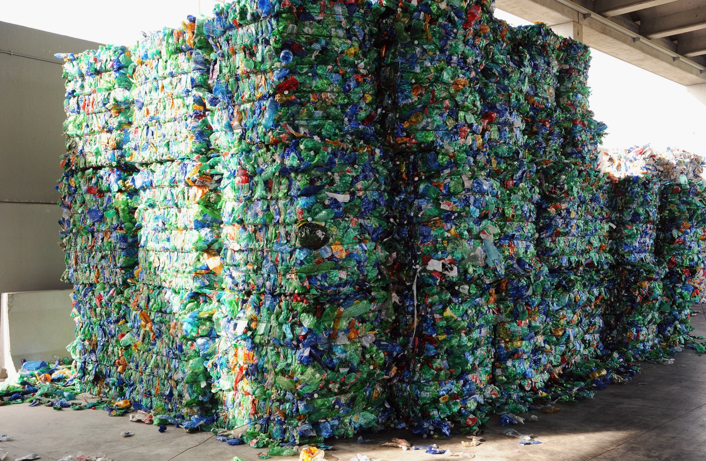 LIVORNO, ITALY - MAY 24: A view of bales of materials of colored plastic bottles ready to be recycled including the plastic waste collected by the fishermen during the operations of 'Arcipelago Pulito' project in the Tyrrhenian Sea is dispalyed in the company Revet Recycling on May 24, 2018 in Pontedera near Pisa, Italy. As part of the ' Arcipelago Pulito ' project in Tuscany, fisherman bring ashore the plastic they have collected on their fishing trips for recycling at a specialised plant. The project is the result of an agreement between the Tuscan Region, the Ministry of the Environment, Unicoop Firenze and Revet Recycling with the total supervision of the Coast Guard of Tuscany. About 10% of the volume of each fish haul caught is plastic waste. (Photo by Laura Lezza/Getty Images)