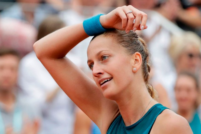 Czech Republic's Petra Kvitova reacts after a point during her women's singles second round match against Spain's Lara Arruabarrena on day four of The Roland Garros 2018 French Open tennis tournament in Paris on May 30, 2018. / AFP PHOTO / Thomas SAMSONTHOMAS SAMSON/AFP/Getty Images