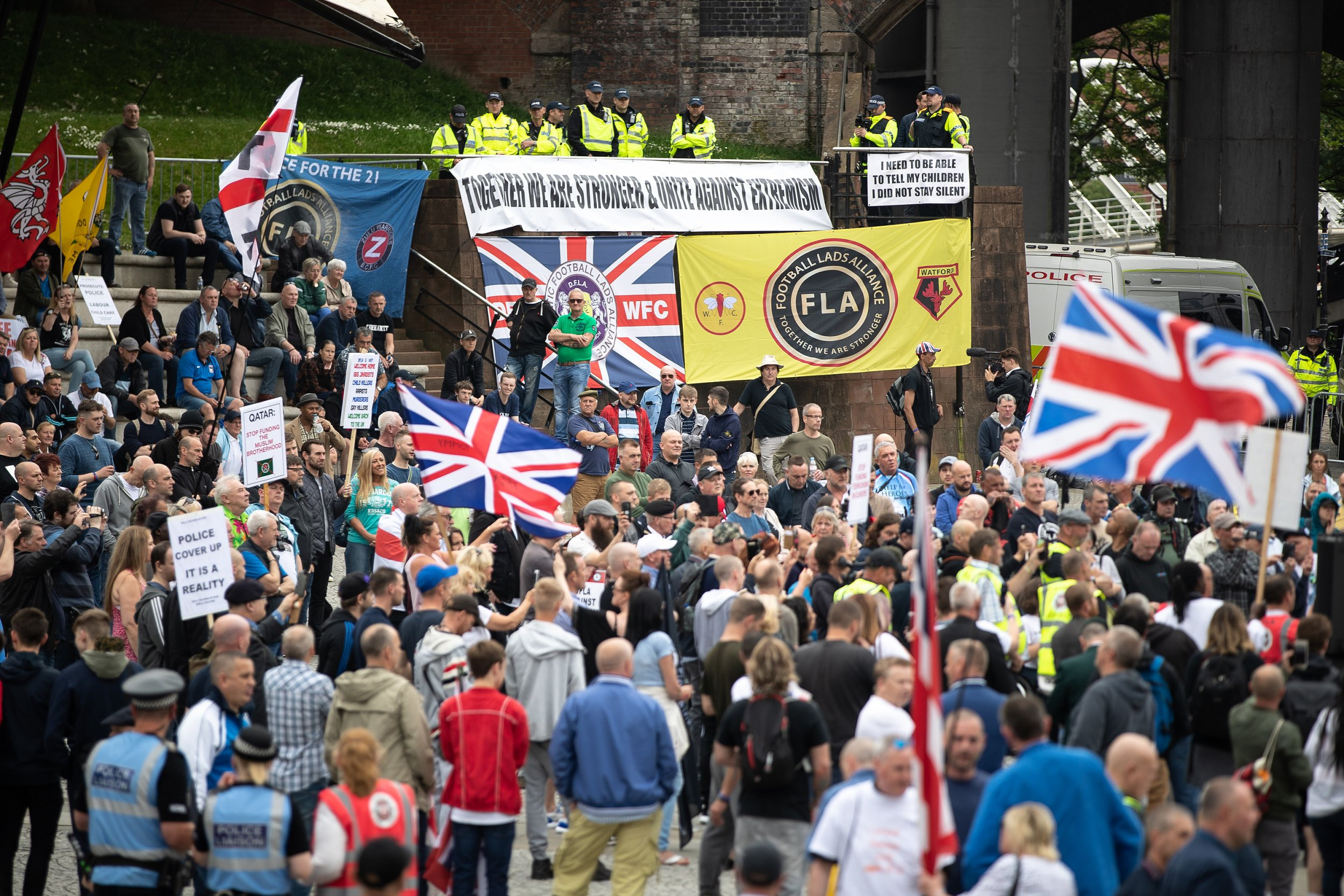 ? Licensed to London News Pictures . 02/06/2018. Manchester, UK. Approximately 1,000 Democratic Football Lads Alliance supporters demonstrate at Castlefield Bowl in Manchester , eleven days after the first anniversary of the Manchester Arena terror attack . Photo credit : Joel Goodman/LNP