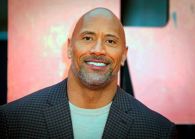 """FILE - In this April 11, 2018, file photo, actor Dwayne Johnson poses for photographers at the premiere of the """"Rampage,"""" in London. Johnson has a new friend on social media and he lives under the sea. SpongeBob Squarepants on Friday, June 1, tagged Johnson in a tweet asking what inspired his nickname. (Photo by Vianney Le Caer/Invision/AP, File)"""