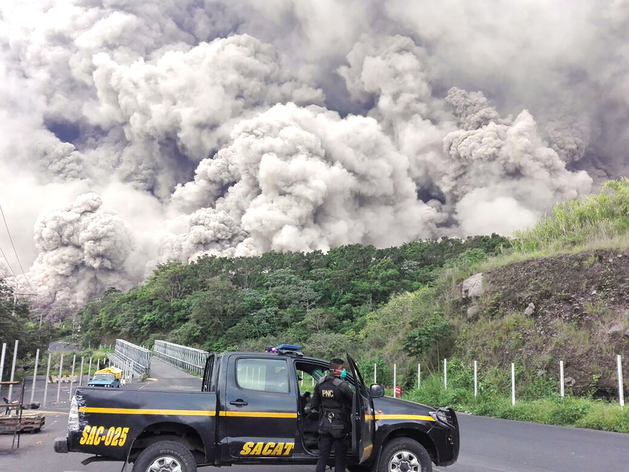 This handout picture released by the National Police of Guatemala shows policemen during search operations around Volcano Fuego after an eruption in Guatemala on June 3, 2018. Emergency workers resumed on Monday for Guatemalans missing after the eruption of the Fuego volcano on June 3, which belched out clouds of ash and flows of lava and left at least 25 people dead according to disaster agency spokesman. / AFP PHOTO / National Police of Guatemala / HO / RESTRICTED TO EDITORIAL USE - NO MARKETING NO ADVERTISING CAMPAIGNS - DISTRIBUTED AS A SERVICE TO CLIENTS HO/AFP/Getty Images