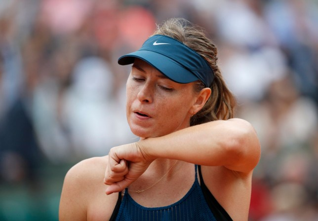 Russia's Maria Sharapova wipes her face during her quarterfinal match of the French Open tennis tournament against Spain's Garbine Muguruza at the Roland Garros stadium in Paris, France, Wednesday, June 6, 2018. (AP Photo/Christophe Ena)