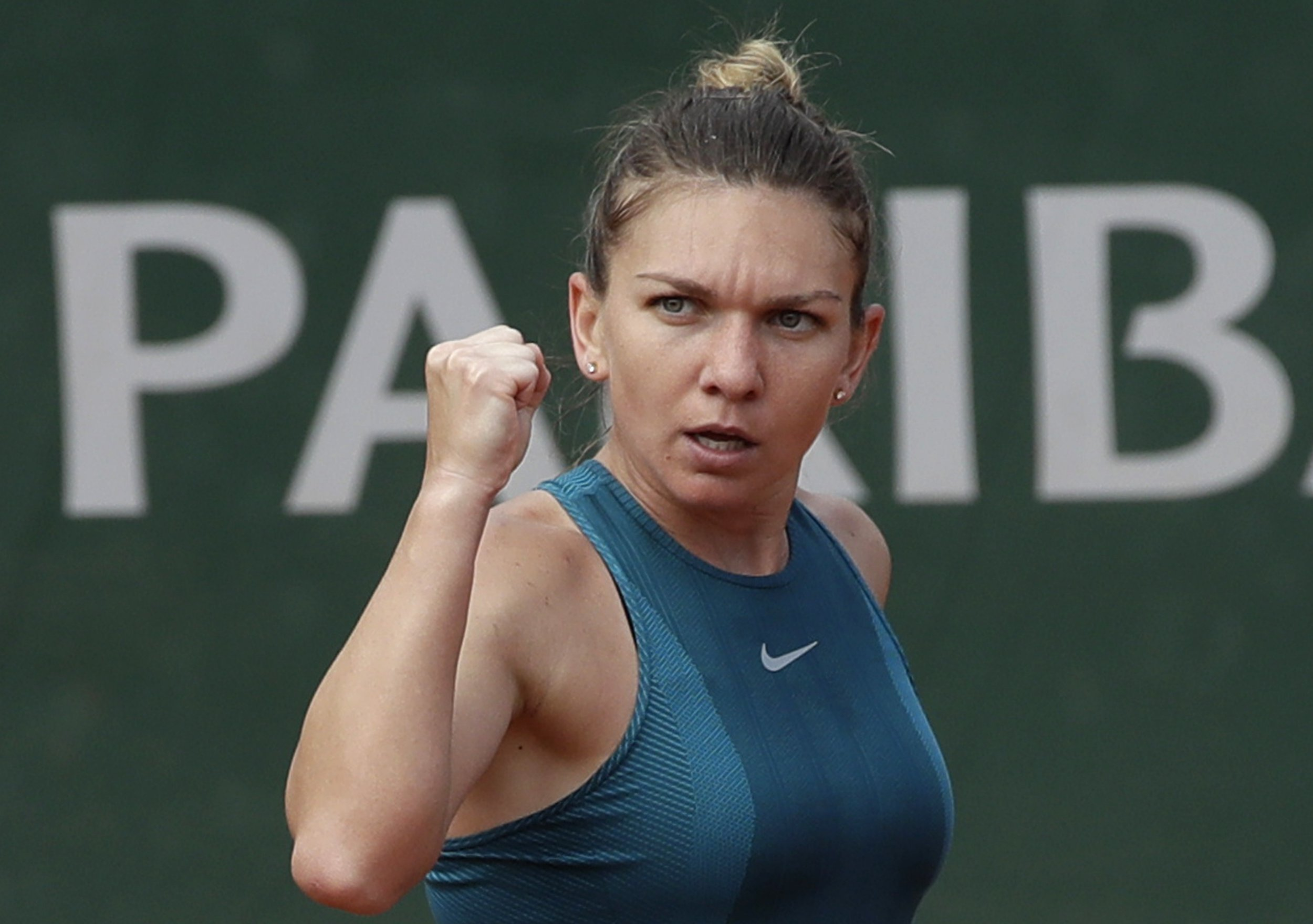 Romania's Simona Halep reacts after winning a point against Germany's Angelique Kerber during their quarterfinal match of the French Open tennis tournament at the Roland Garros stadium, Wednesday, June 6, 2018 in Paris. (AP Photo/Alessandra Tarantino)
